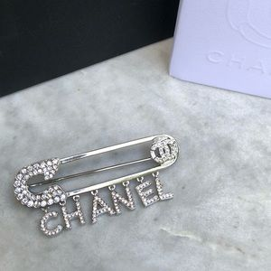 CHANEL Safety Pin Charmed Brooch